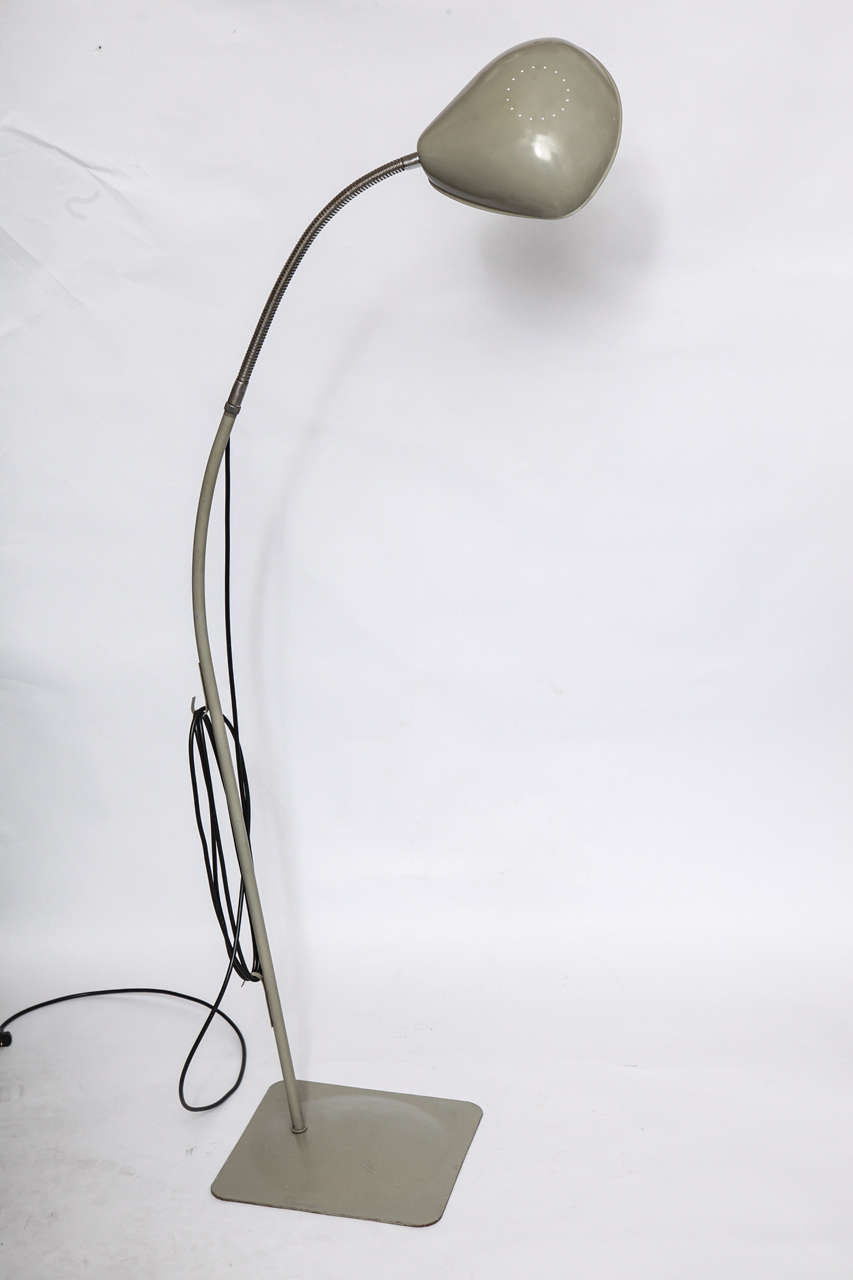 A 1950s articulated floor lamp.