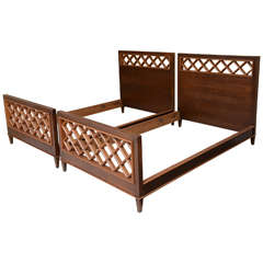 Pair of French, Modern Mahogany and Fruitwood Beds of Jacques Adnet