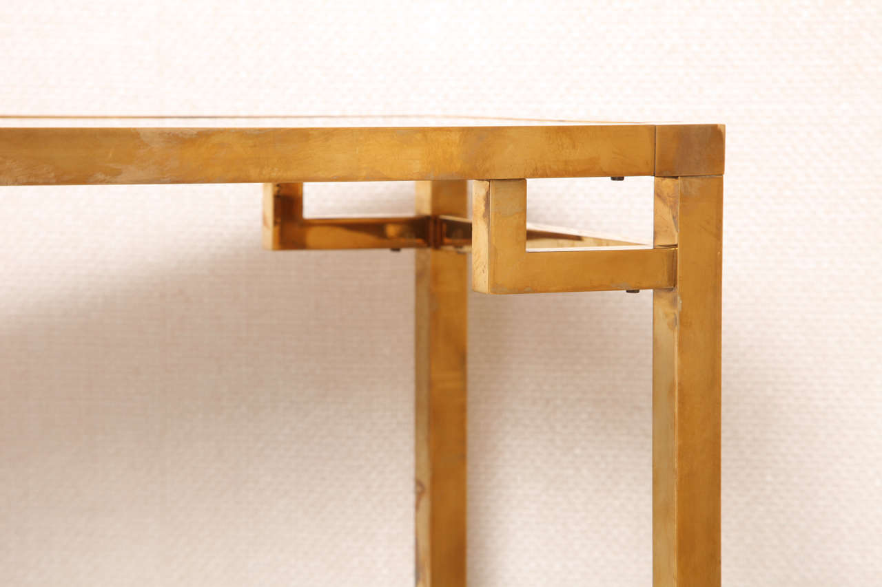 A Small Geometric Two Tier Brass And Antique Glass Console