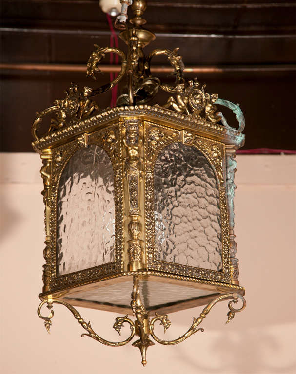 A PAIR OF  SQUARE  HALL LANTERNS WITH RIPPLED  GLASS,  FOLIATE DECORATION, FIGURES AT CORNERS, SWAGS, ELECTRIFIED,  missing   3  panels of  glass