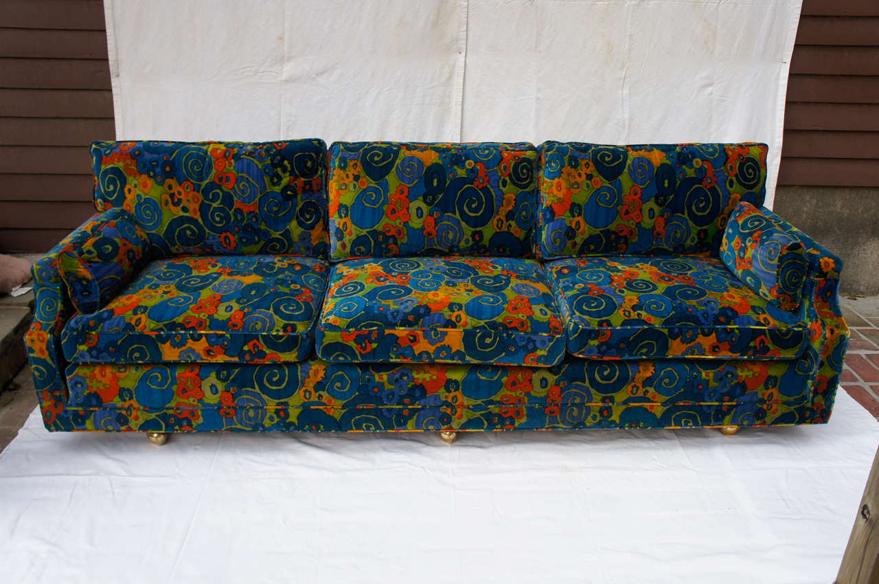 This sofa is sooo groovy baby, it will surely bring back your mojo! Velvet stunning with very little ware at all. Just really on the piping in a couple of spots. Cushions, down feathers and perfect! No tears, no odor, practically new! They even