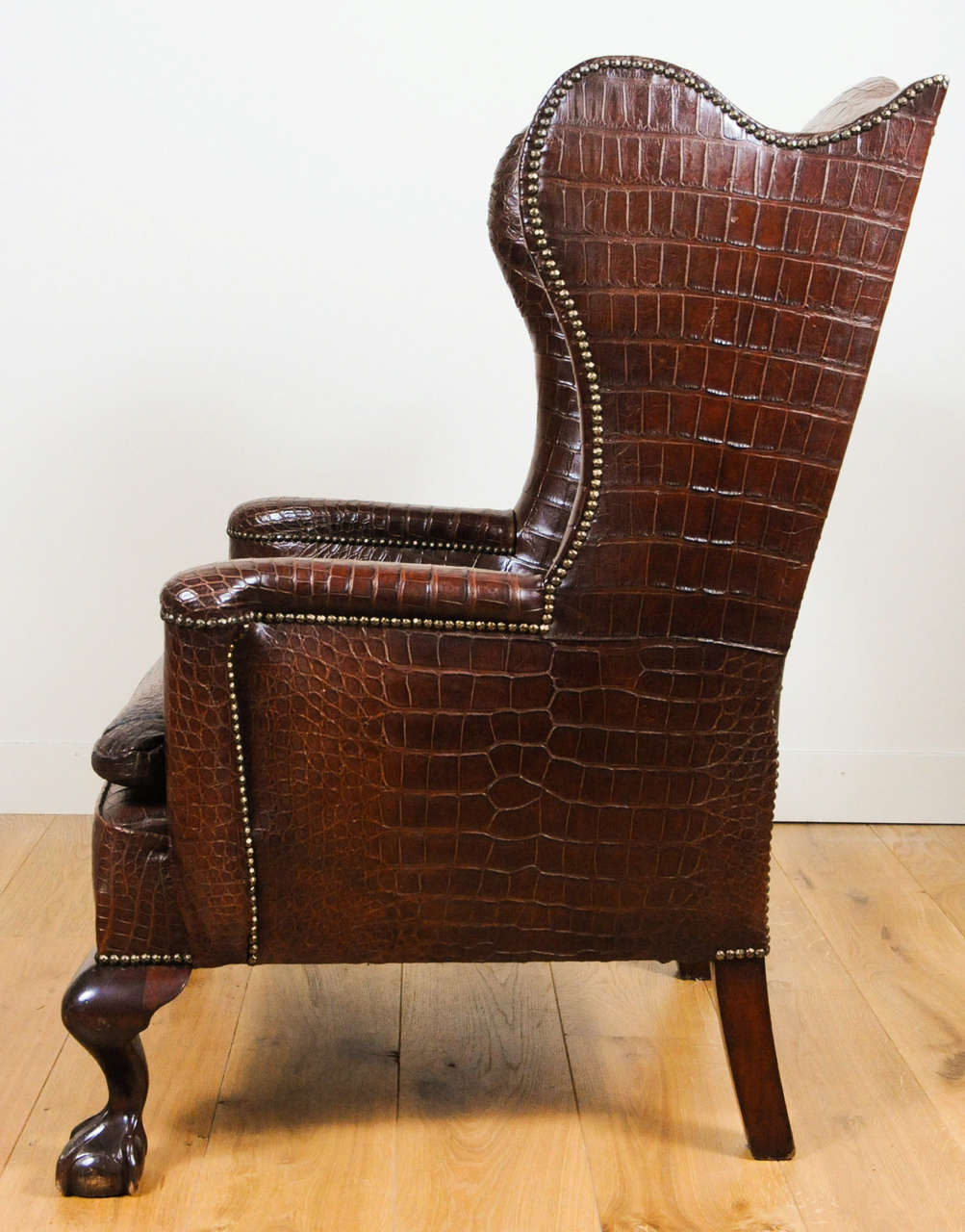 Very unusual and chic crocodile upholstered wing chair at 1stdibs