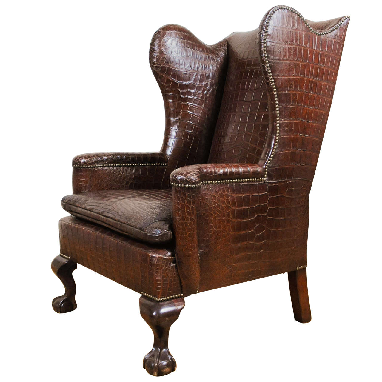 A very unusual and chic crocodile upholstered wing chair for Unusual chairs