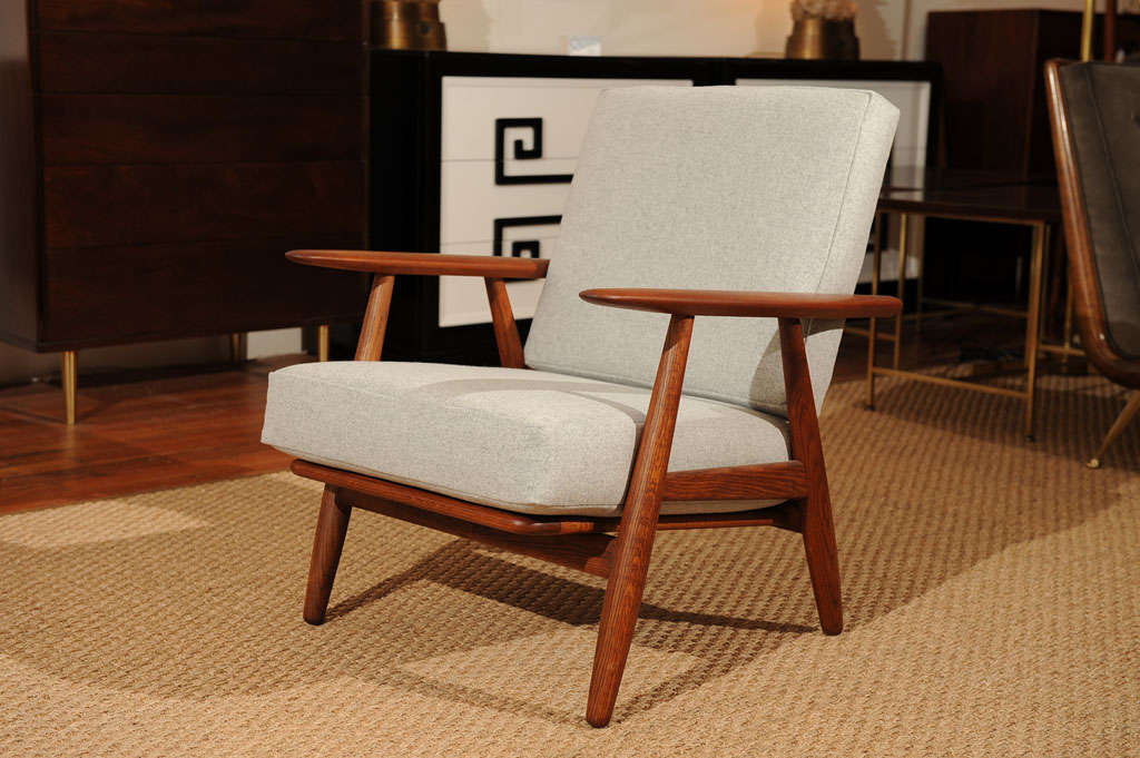 Simple and masculine armchair designed by Hans Wegner for Getama, Completely restored and upholstered Maharam felt. Net $2400.00