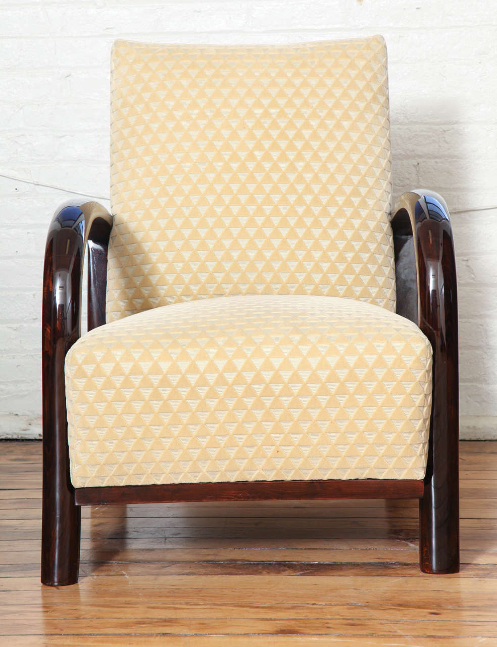 A pair of Art Deco armchairs. Palissandre frame and newly upholstered.