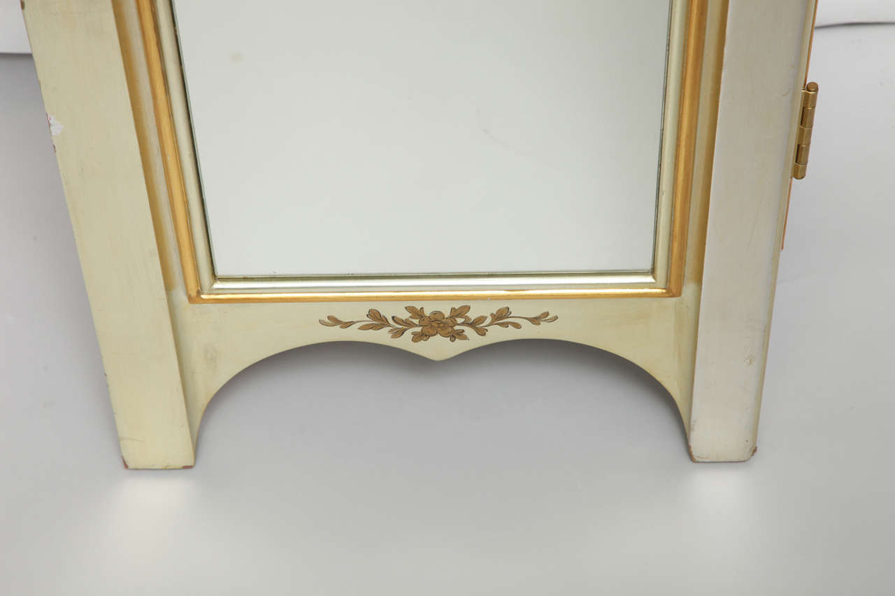 Mirrored Cabinet With Gold Wood Trim And Interior Drawers
