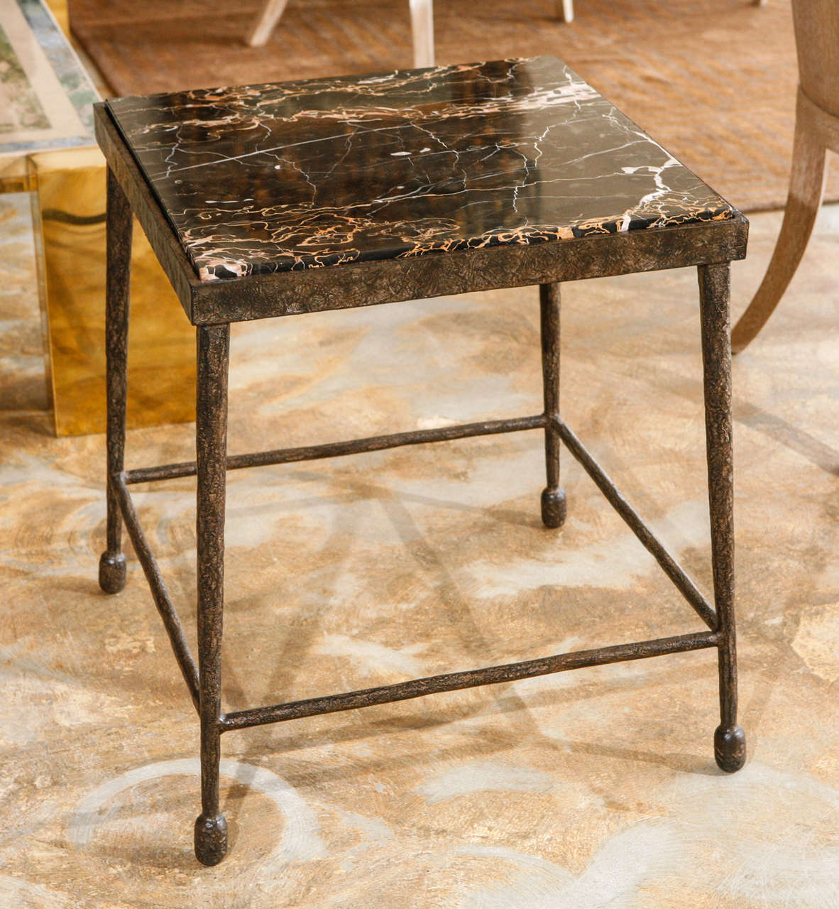 Modern, organic stone and textured iron side table. Giacometti flare. Single as shown in stock. Price is for the single table in stock, and the stone is no longer available. Also available to order with other top materials (see our separate listing