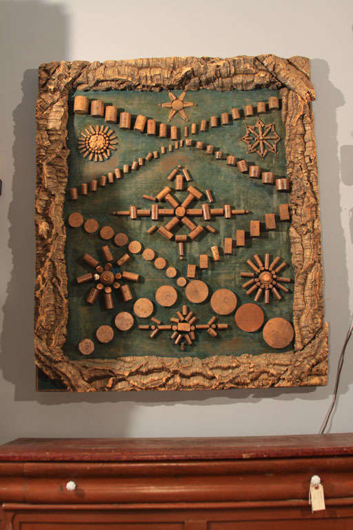 Folk Art Cork Manufacturer's Display piece with samples of all sizes and shapes of cork available for sale.  Corks are arranged in geometric shapes and mounted on a velvet-covered board, framed in 5-inch raw cork border.