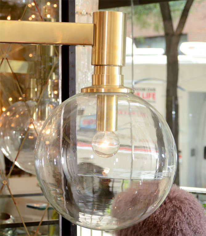 Brass Three-Arm Chandelier with Clear Glass Spherical Shades In Good Condition For Sale In New York, NY