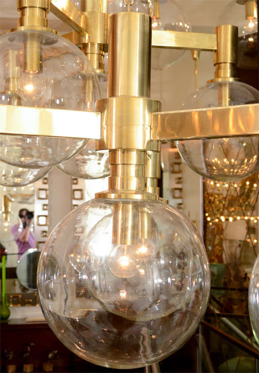 Mid-20th Century Brass Three-Arm Chandelier with Clear Glass Spherical Shades For Sale