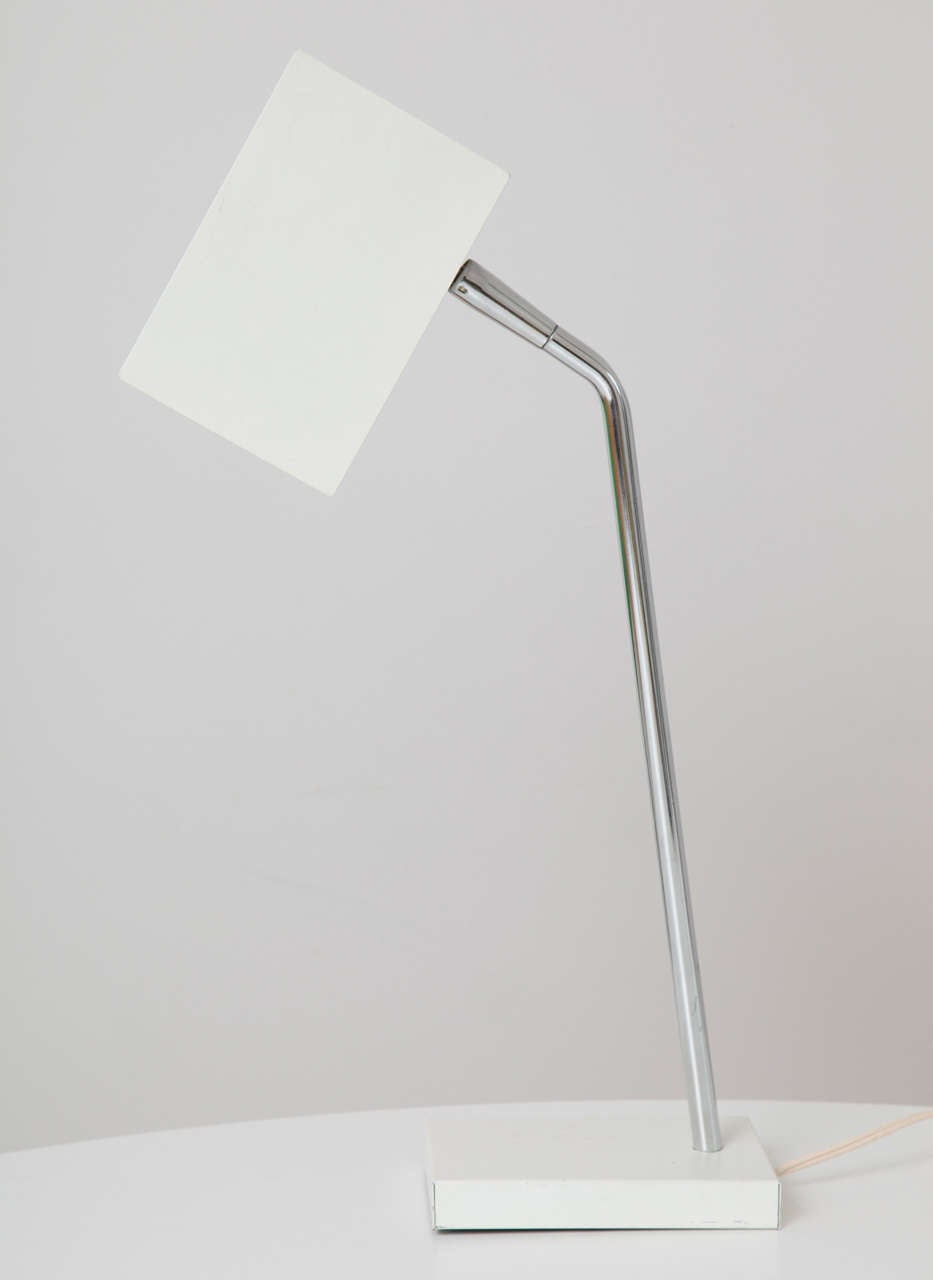 Two crisp, angular lamps in white by Robert Sonneman for Kovacs. Price is for the pair. Please contact for a detailed condition report.