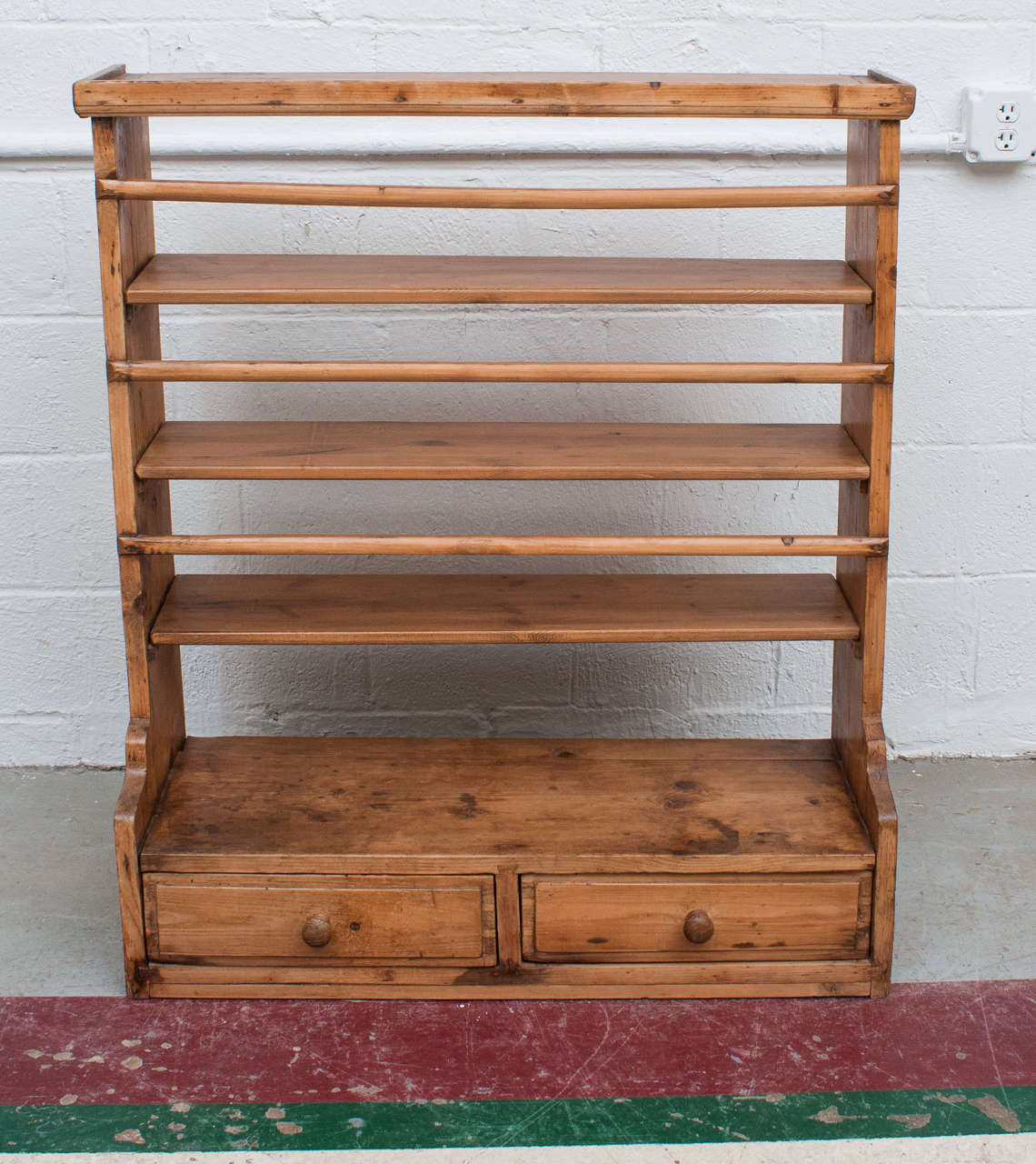 A charming two-drawer hanging plate rack featuring all morticed and dovetailed construction with four & Pine Hanging Plate Rack For Sale at 1stdibs