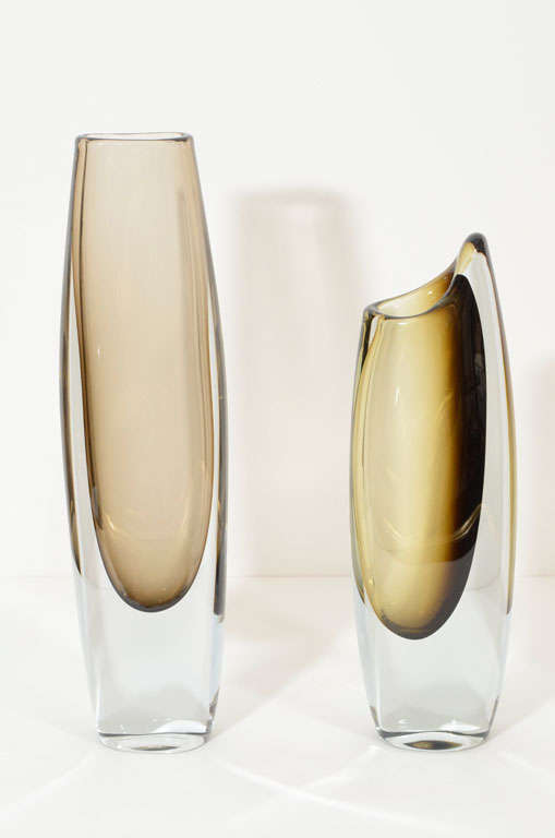 A pair of decorative, mid-century modern vases by Strombergshyttan, Sweden, circa 1950. Each vase is $950. Tall vase is sold. Medium size vase is H 11'', L 3.75.