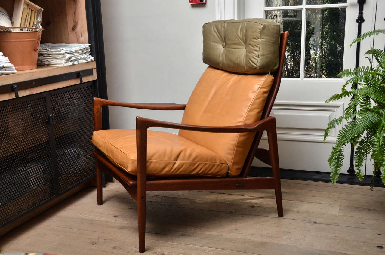 Stunning midcentury Scandinavian lounge chair with teak frame and newly re-upholstered in calf leather in the style of Kofod Larsen.