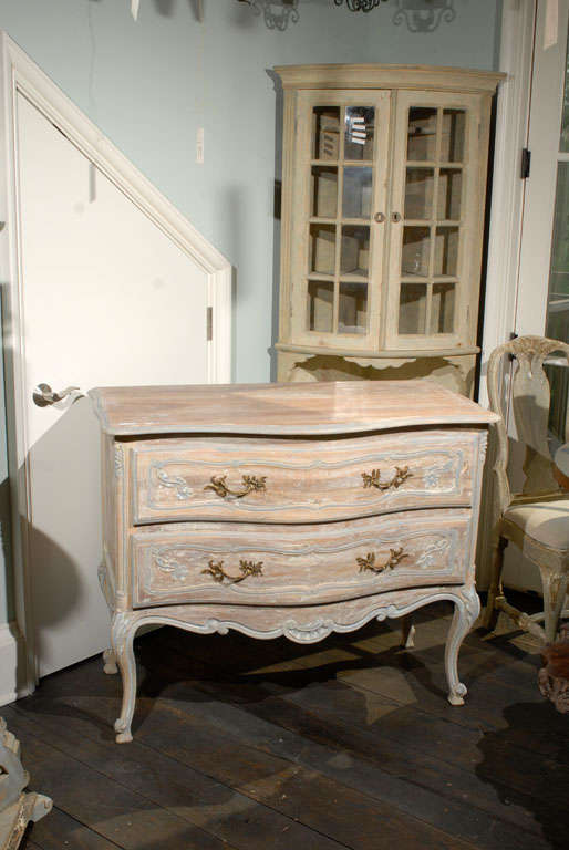 A French Two-Drawer Chest with Nice Delicate Carving Details, Scalloped Skirt and Standing on Tall Cabriole Legs. Mid 20th Century.
