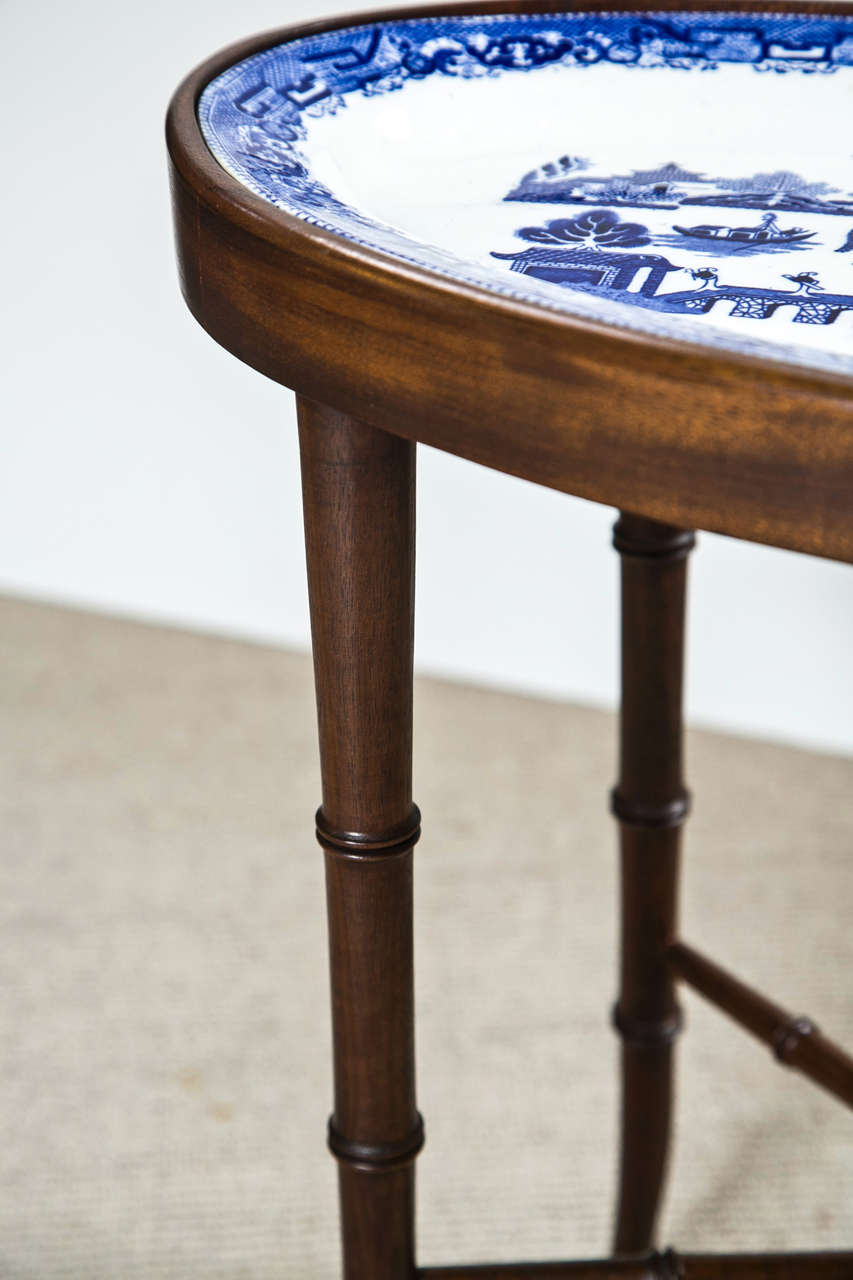 Faux Bamboo Table Fitted With Blue Willow Oval Platter At