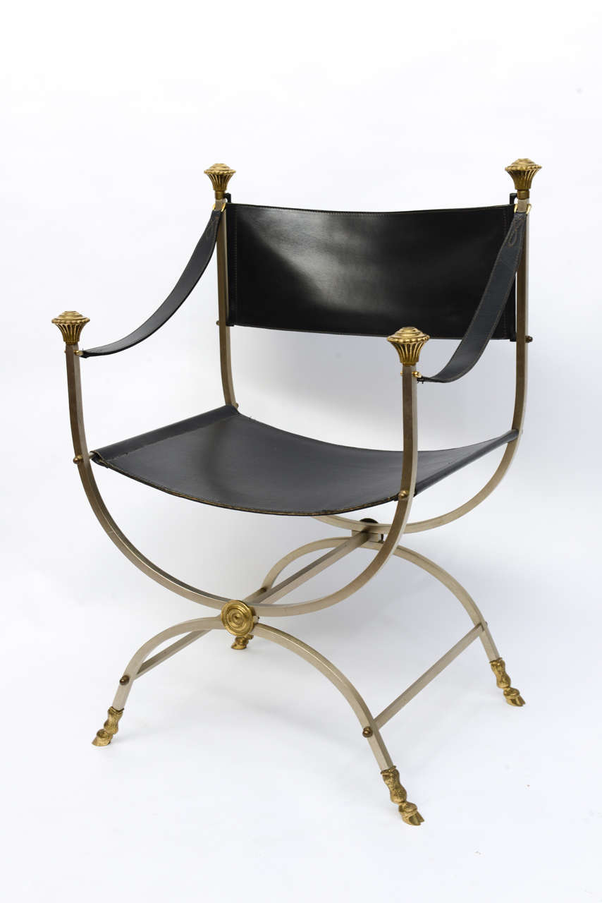 Stunning pair of stainless steel and brass framed black leather Savonarola chairs.  Beautifully accented with hoofed feet, knobs and medallions.