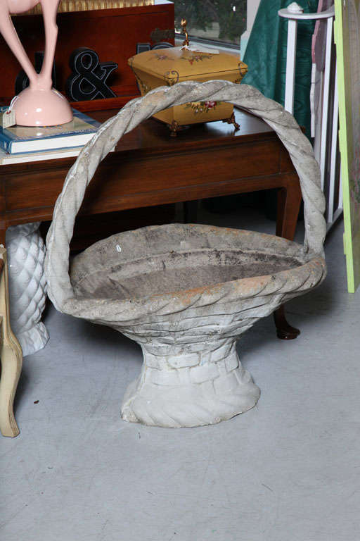 Very lovely composite stone basket with rope handle.