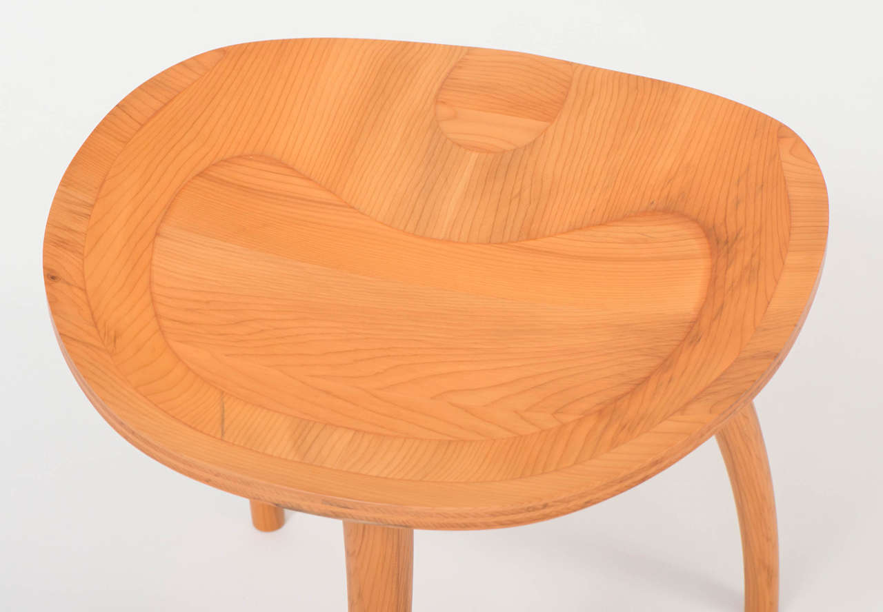 """A Thebes stool in English yew wood by John Makepeace. One of an edition of six. The seat is made of layers at right angles in a curved handmade """"plywood."""" The layers have been sculpted to enhance the comfort and to express the structure."""