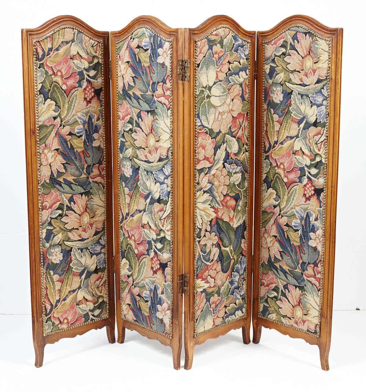 Small Provincial folding screen with 4 arch-top panels with short cabriole legs inset with floral tapestry.