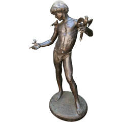 Bronze of a Standing Nude Youth with Birds