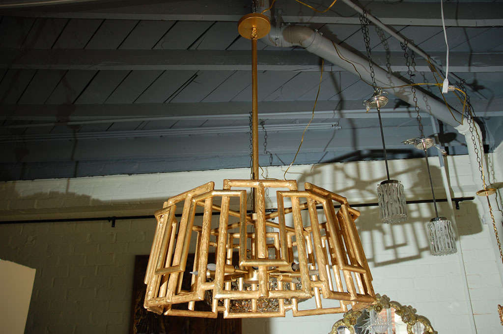 Paul Marra trellis chandelier shown in gold leaf and with eight-light sputnik cluster. Modern, organic modern style. Limited availability, by order.