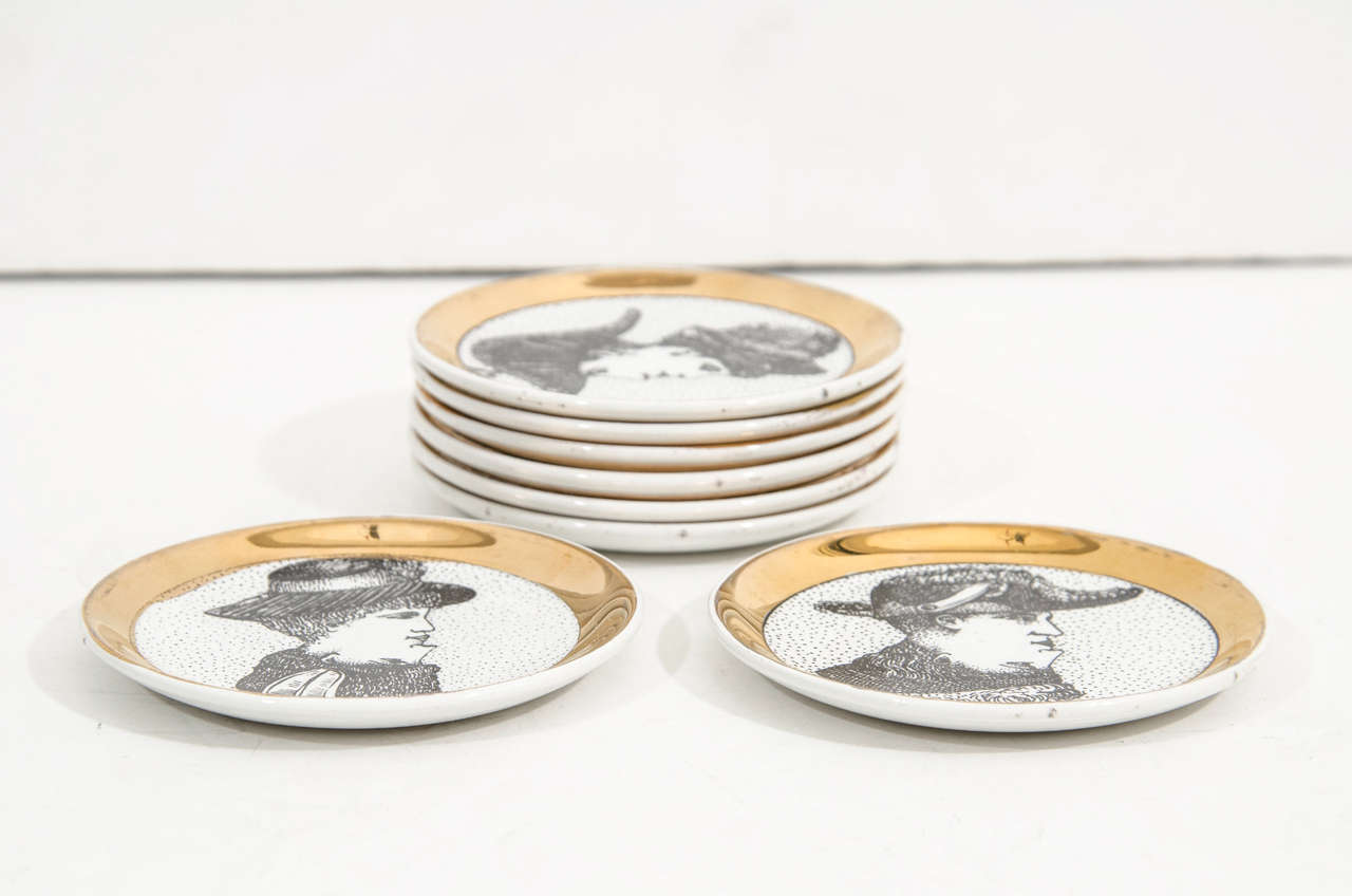 A Mid Century Set Of Eight Porcelain Fornasetti Coasters