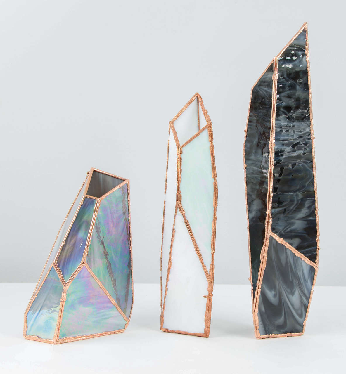 The price and dimensions shown are for the largest size.  OverNight vases, are a collection of unique glass and copper mixed colored vases by Odd Matter, a partnership of Dutch native, Els Woldhek and Bulgarian, Georgi Manassiev.  Taking