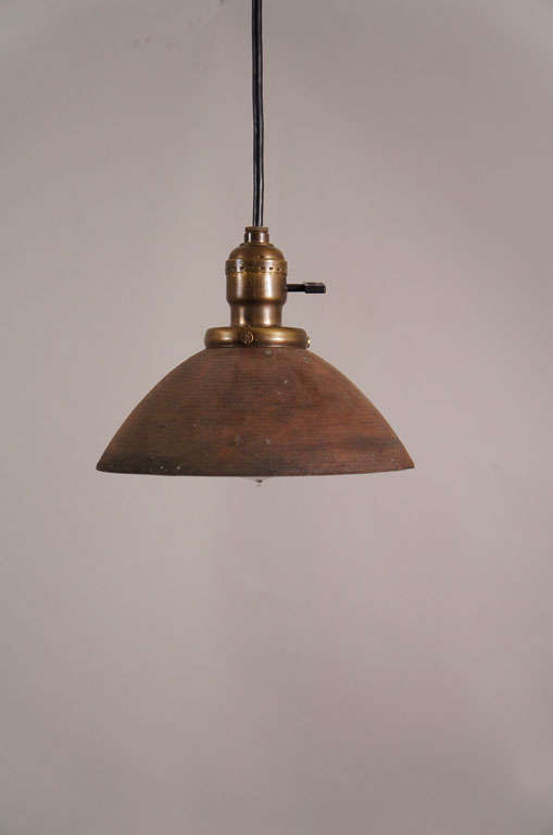 Antique spun metal shade with silvered interior and warm brown painted exterior.  All original.  Black rubber cord with turnkey socket, ceiling cap included.
