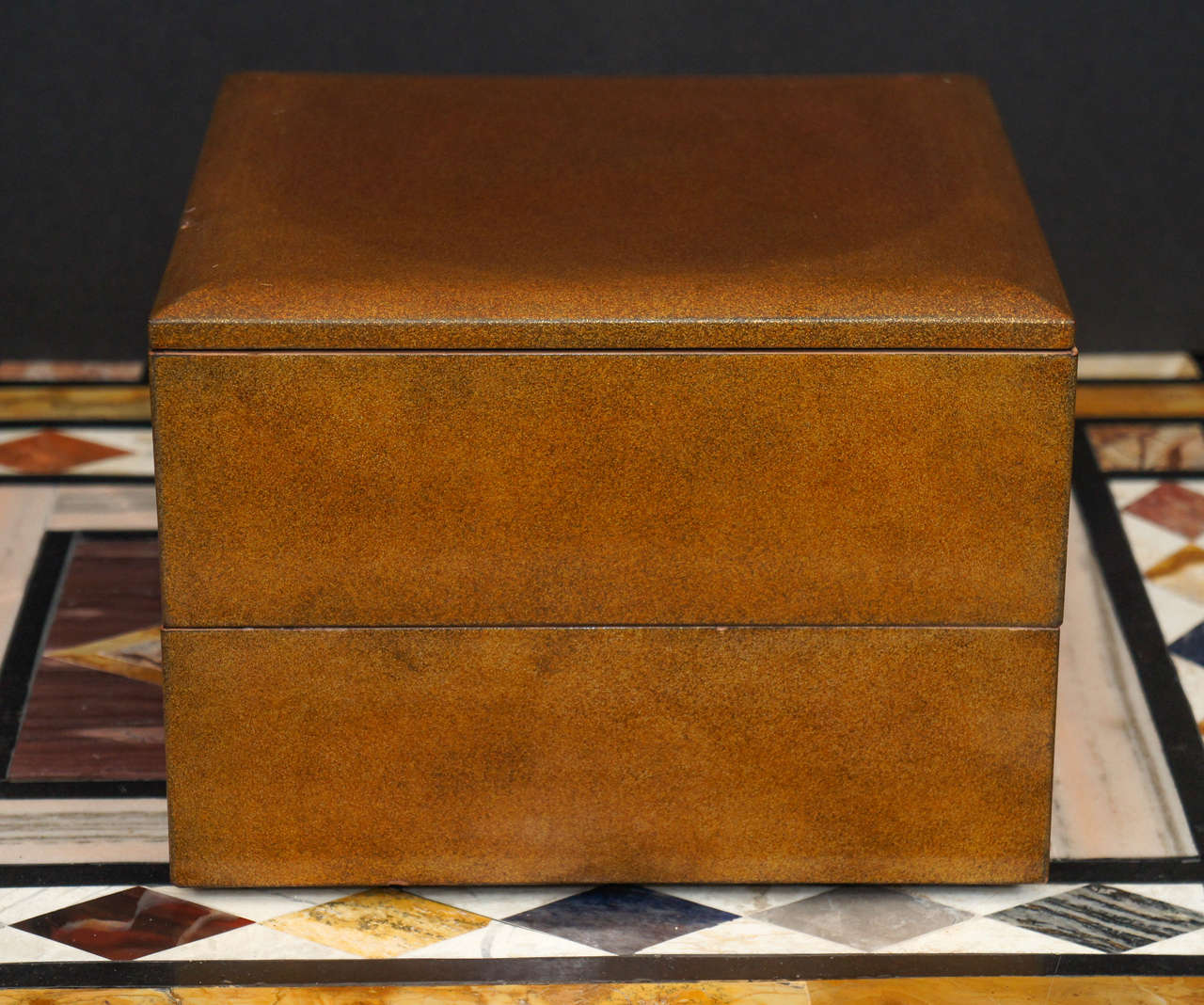 This very beautifully lacquered box is from the Meiji period in Japan. Made between 1864 and the end of the 19th century this small two tied box would have been a luxury item for storage or personal effects. Crafted with an all-over exterior gold
