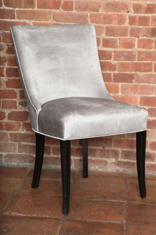 The Mid-Century slipper side chair is in the manner of Billy Haines. It's elegant and comfortable. Sleek and stylish. Their slender legs and high back make them a very chic pair. Perfect to create an elegant entrance or focus corner. Price is by the
