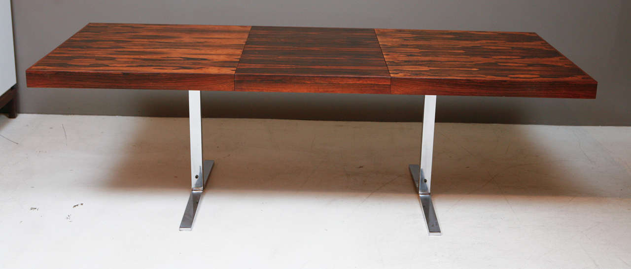Rosewood Dinning Table with folding hidden leaf by Georg Petersens.  Heavy Tressel base.