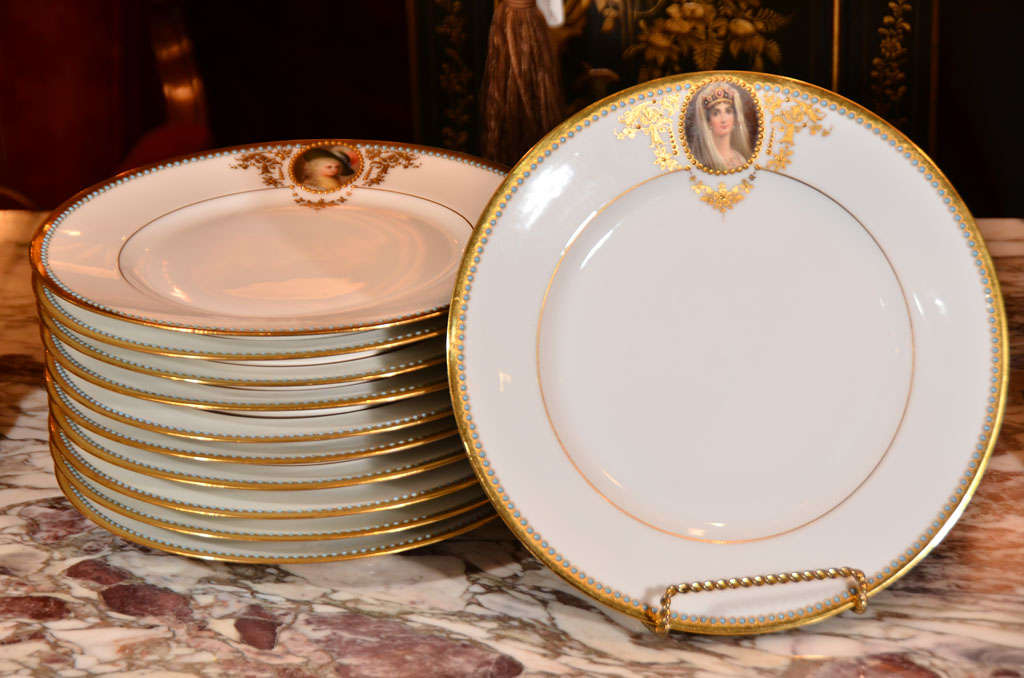 19th c set of 11 porcelain signed Wagner cabinet plates. Hand painted with raised gold detail