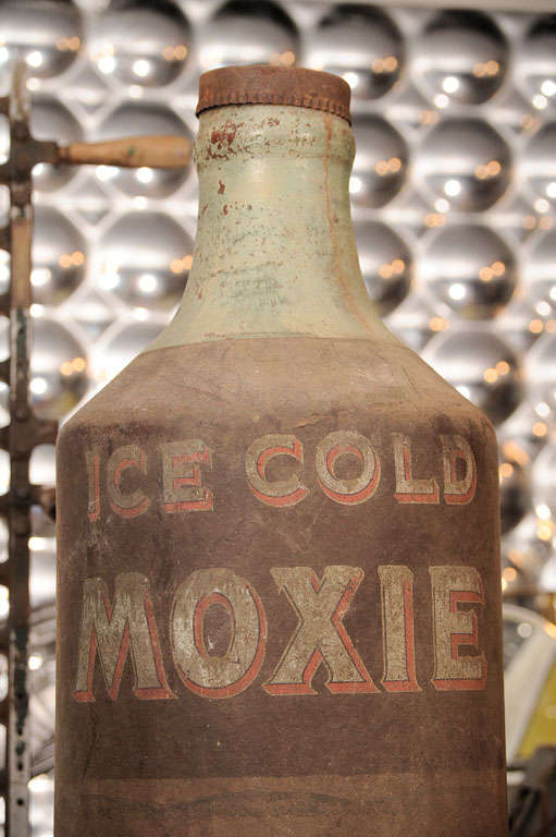 Moxie is a carbonated beverage that was one of the first mass-produced soft drinks in the United States. It continues to be regionally popular today. It is the main ingredient in the New Englander cocktail. This trade sign is probably circa the