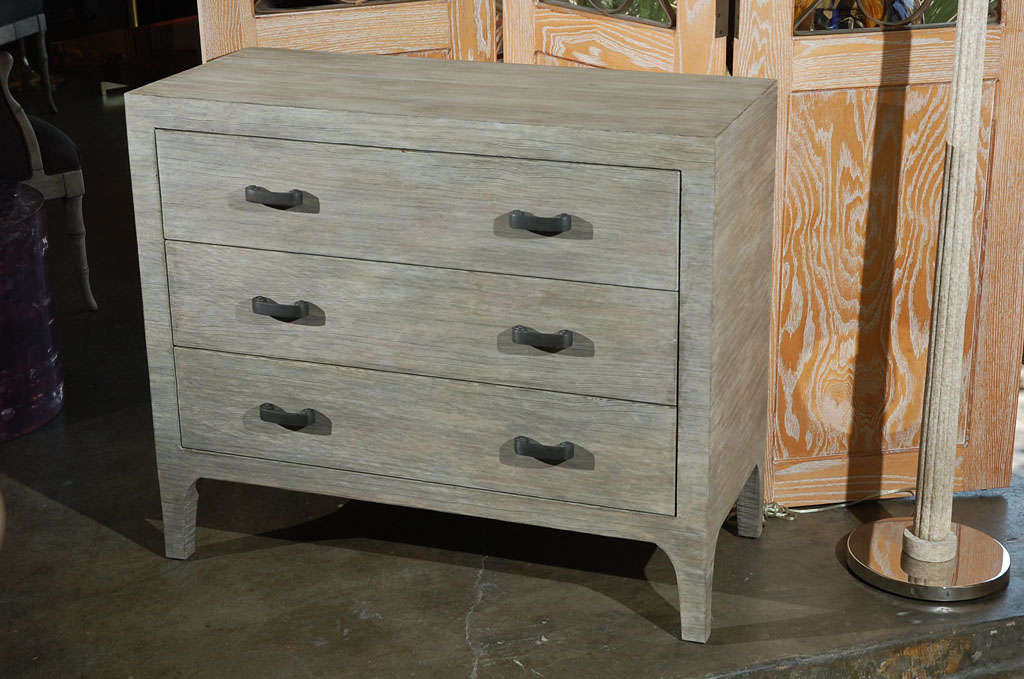 Paul Marra three-drawer fir wood chest shown with new distressed finish and custom hardware. Custom hardware is cast brass in oil rubbed bronze. The main image version by order. See last two photos of in-stock pair with slightly lighter finish and