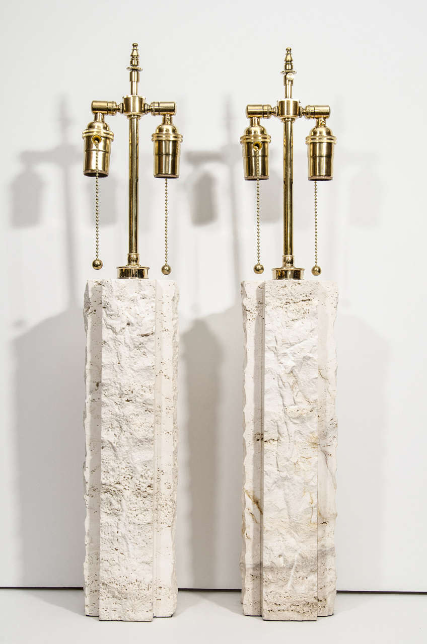 Pair of limestone table lamps with brass hardware.