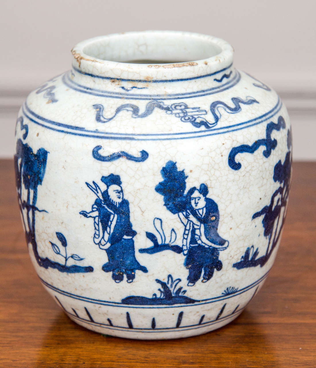 This single early 20th-century Chinese blue-and-white porcelain jar is ornamented in cobalt blue with figures in an abstracted landscape.