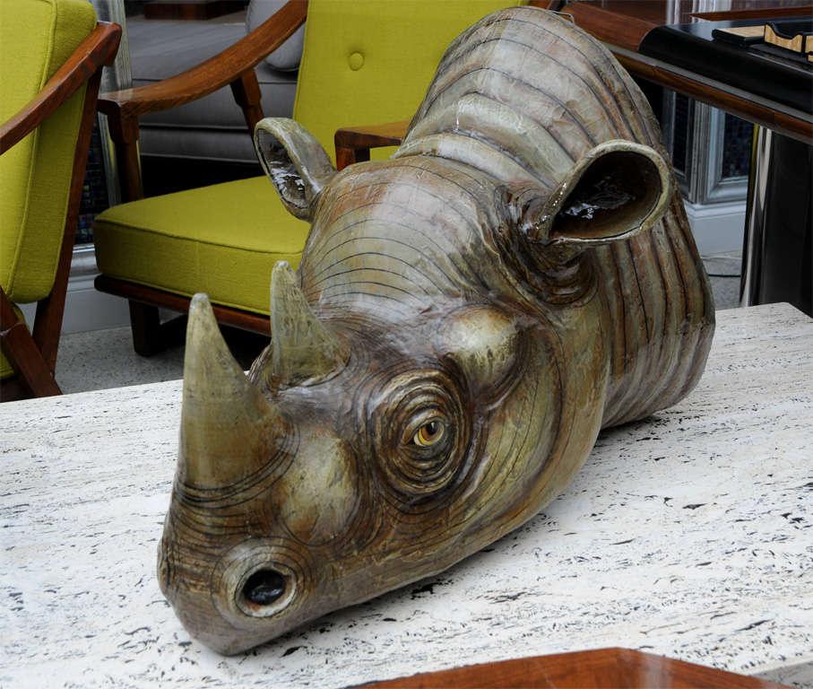 A Sergio Bustamante wall hung rhino head. Painted papier mâché.