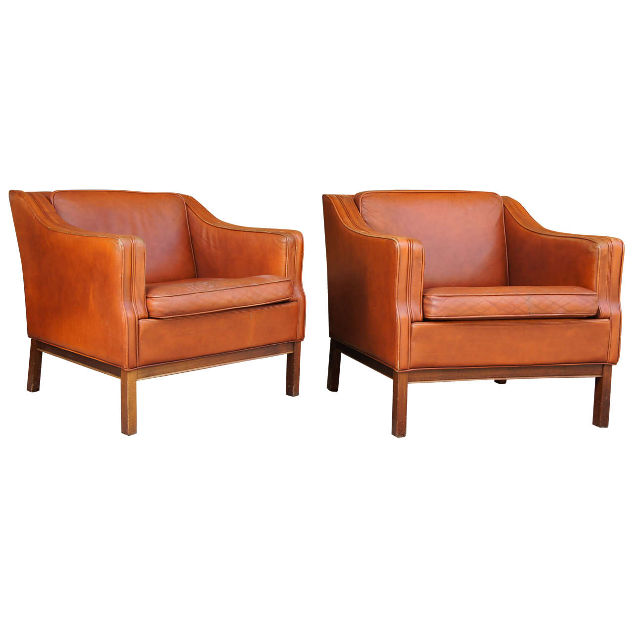 A pair of danish modern leather upholstered club chairs at for Modern leather club chairs