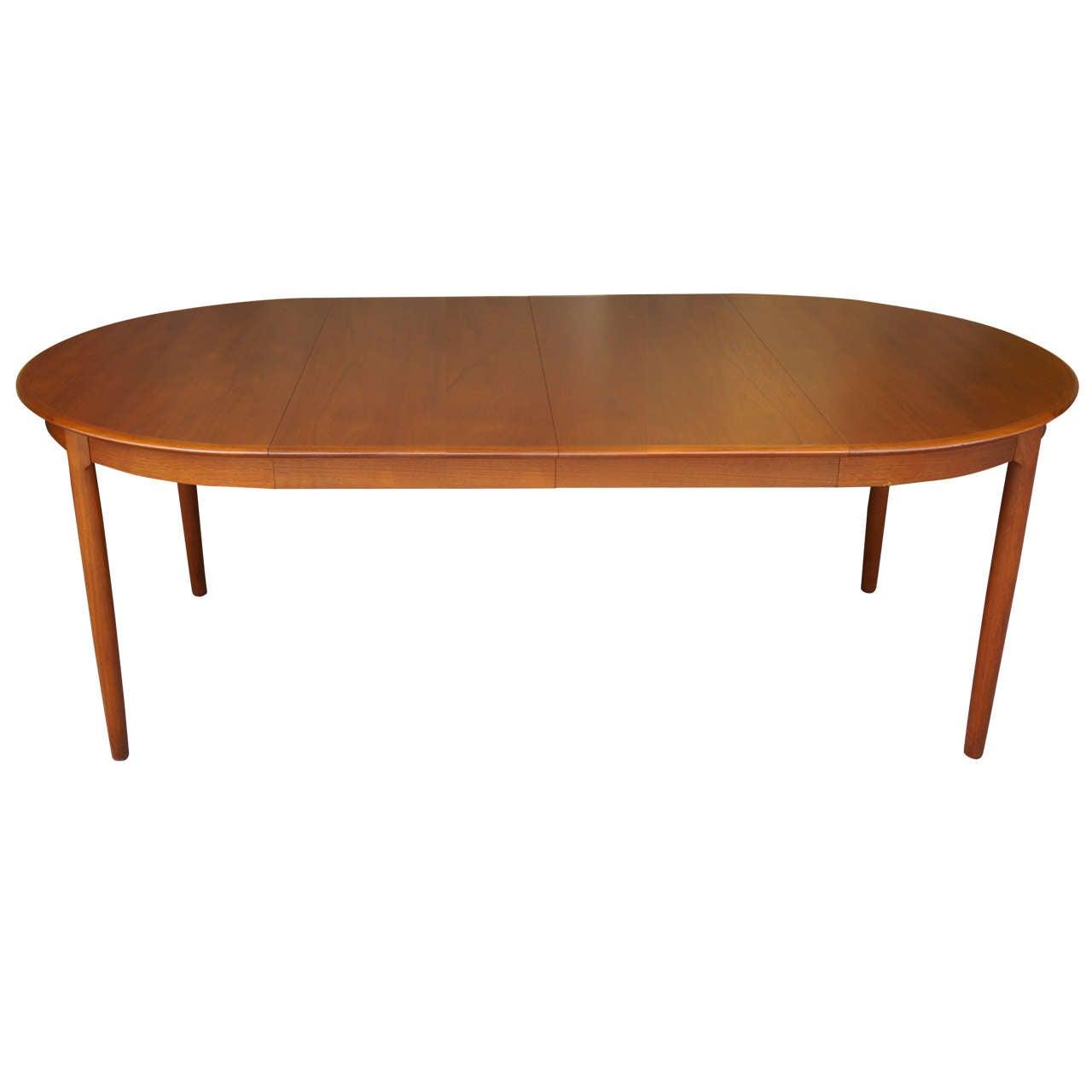 Danish modern teak dining table at 1stdibs for Modern dining table