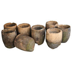 Eight Antique Graphite Crucibles