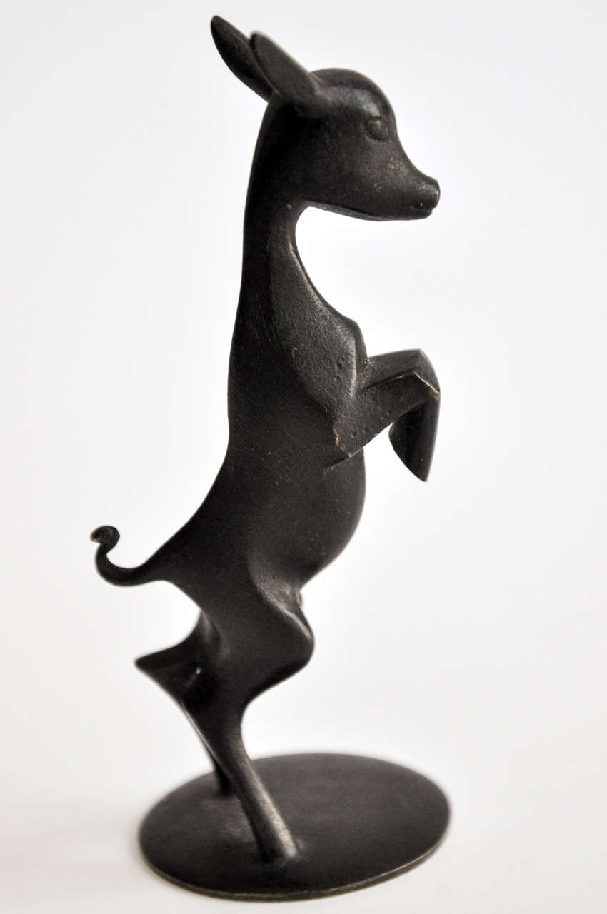 A small bronze animal sculpture handmade by Hagenauer, Vienna, Austria. Fine detailing and rich original patina. Signed.