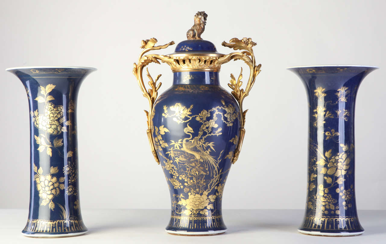 A set of three 18th century, Chinese powder-blue gilt-decorated vases Each painted with composite floral patterns, the jar with the lion-shaped finials cover with a 19th century, French ormolu-mounted  Measures: cm 39 jar cm 53.
