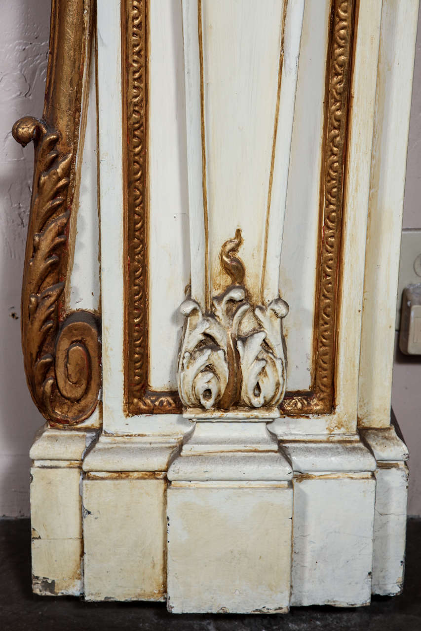 1950s large Greek Revival style ornate wooden mantel. Salvaged from a lovely home on East 56th Street in NYC. It has a figural lady bust on both sides and a cornucopia in the center. This can be seen at our 400 Gilligan St location in Scranton, PA.