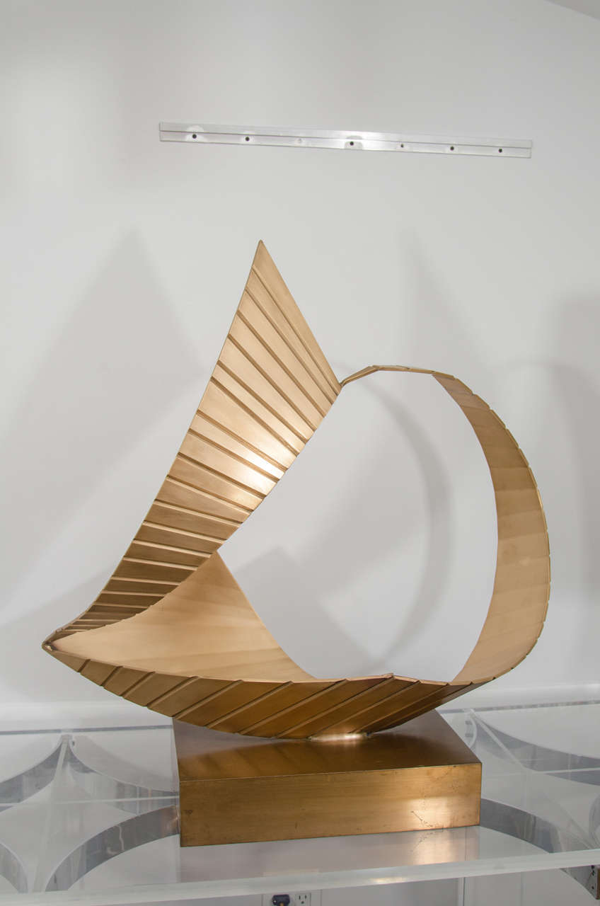 Nautical inspired brass sculpture reminiscent of billowing sails . Finely made with ridge detailing. Very interesting and transforms from a variety of angles.
