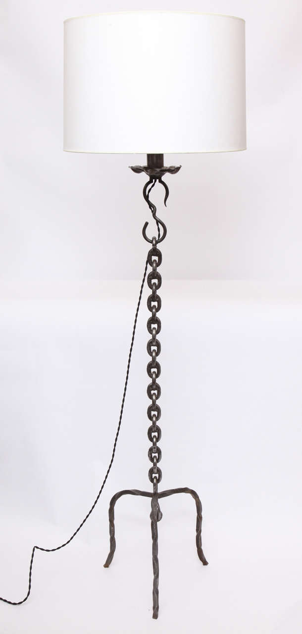 A 1940s hand-wrought iron floor lamp. Shade not included