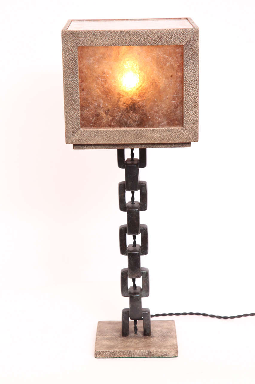 A 1980s French modernist patinated iron and shagreen table lamp.