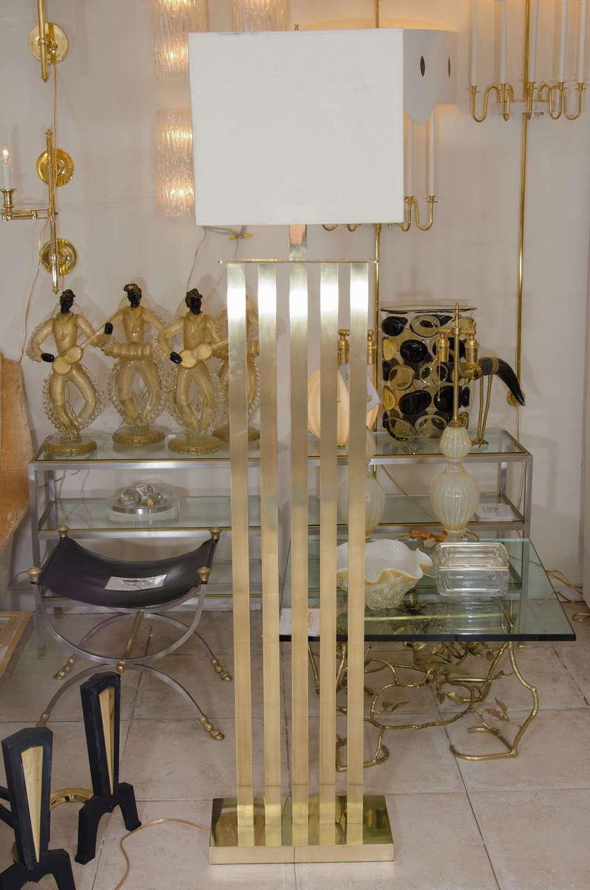 Rectilinear standing brass floor lamp.