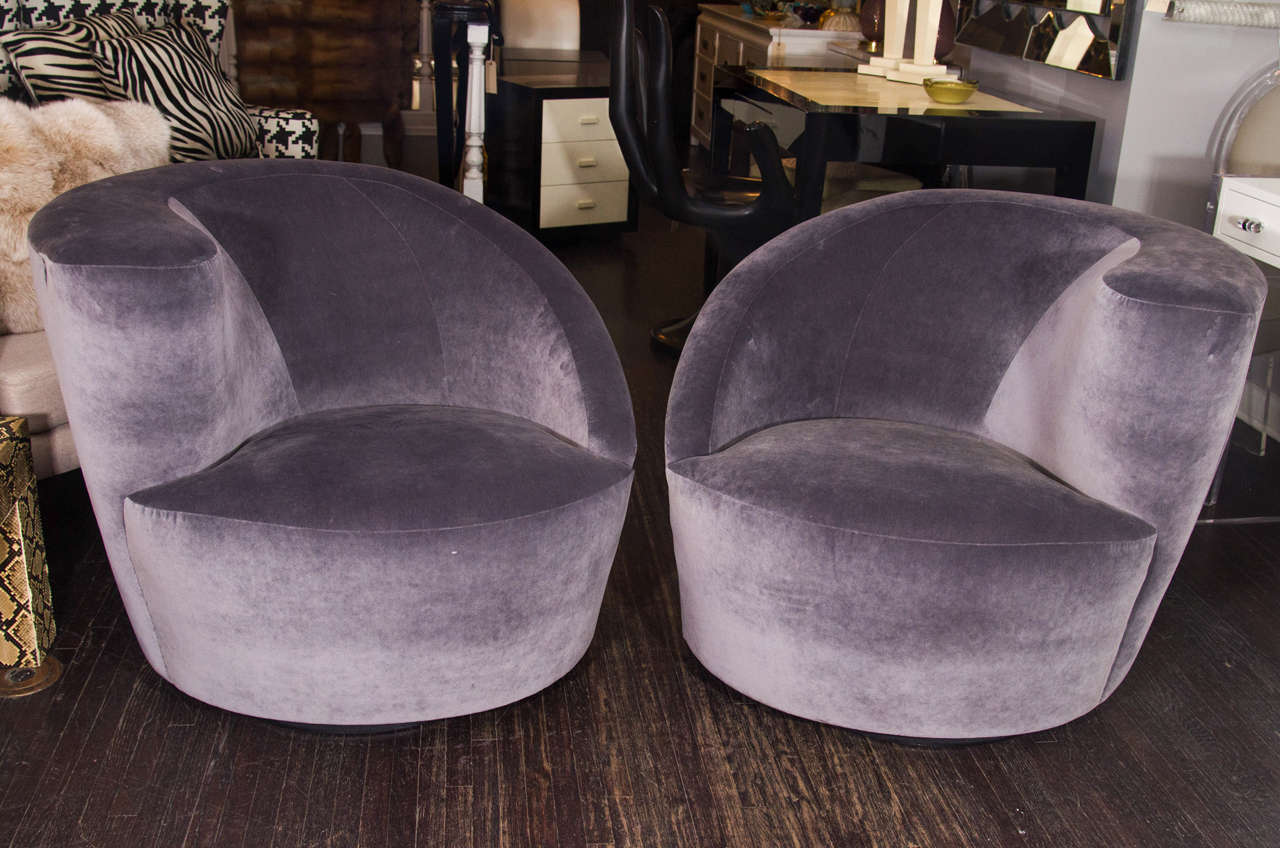 pair of 1970s kagan asymmetrical swivel chairs upholstered in