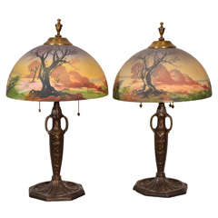 Pair, matching Art Nouvou table lamps with obverse painted shade